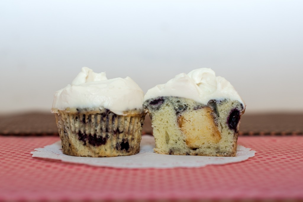 Blueberry cupcake with lemon almond biscotti inside topped with lemon whipped cream frosting