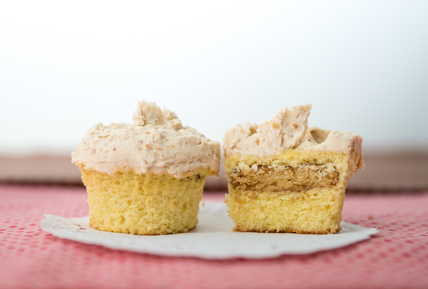 Vanilla cupcake with snickerdoodle inside topped with pretzel buttercream